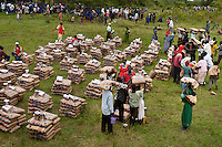 Internally displaced people in a Ugandan IDP camp near Lira, collect 50-Kilo bags of cornmeal delivered in a monthly allotment by a convoy of the UN's World Food Programme. More than two million people had fled their homes in the north, fleeing attacks by the Lords Resistance Army over the course of the 20-year conflict. The LRA has fled to The emocratic Republic of Congo enabling many northern residents to return to their homes.