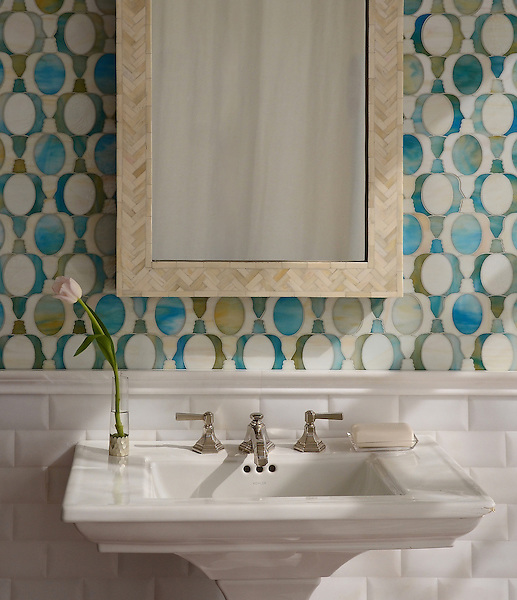 Janus Petite, a waterjet mosaic shown in Aquamarine and Quartz jewel glass, is part of the Illusions® collection by Sara Baldwin for New Ravenna.