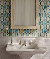 Janus Petite, a waterjet mosaic shown in Aquamarine and Quartz jewel glass, is part of the Illusions™ collection by Sara Baldwin for New Ravenna.