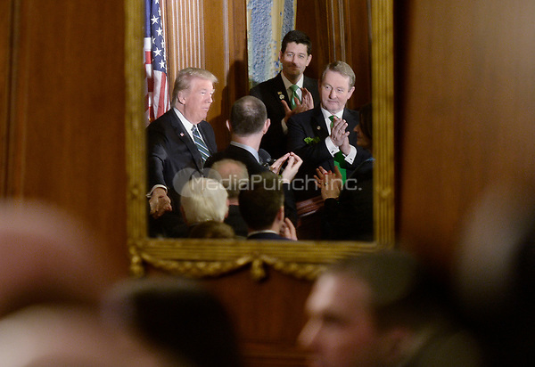 United States President Donald J. Trump (L) with with the Taoiseach of Ireland Enda Kenny (R) and House Speaker Paul Ryan (C) attend the Friends of Ireland Luncheon at the U.S Capitol on March 16, 2017 in Washington, DC. <br /> Credit: Olivier Douliery / Pool via CNP /MediaPunch