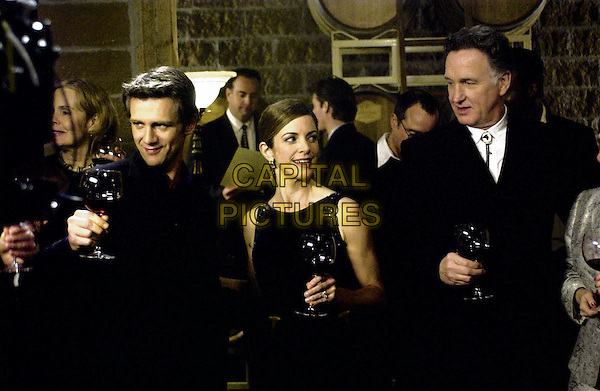 Freddie Dumay( Cynthia Gibb), her husband Alan Leach ( Gordon Currie) and Thomas Shipman ( Tom Butler) toast their newest vintage creation at the Dumay Winery in the suspense drama ïA Crime of PassionÍ PAX TVÍs tenth installment of mystery writer Mary Higgins Clark novels. .Filmstill - Editorial Use Only.Ref: FB.sales@capitalpictures.com.www.capitalpictures.com.Supplied by Capital Pictures..