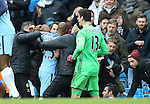 Fernandinho of Manchester City is restrained after Cesc Fabregas of Chelsea ends up in the crowd during the Premier League match at the Etihad Stadium, Manchester. Picture date: December 3rd, 2016. Pic Simon Bellis/Sportimage