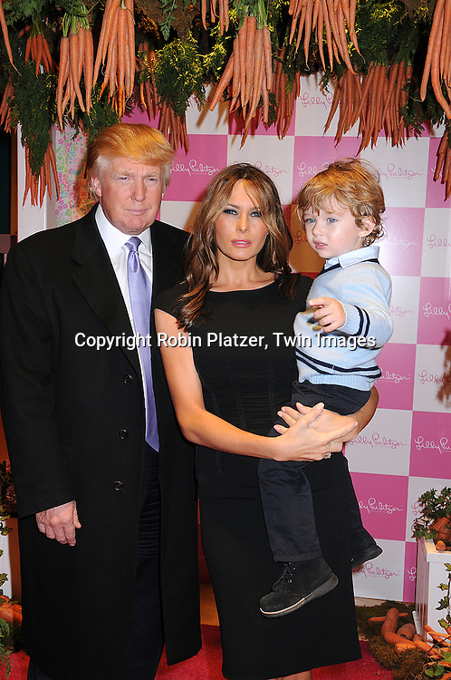 Donald Trump, Melania Trump and Baron Trump.at The 17th Annual Bunny Hop at FAO Schwarz, hosted by The Society of Memorial Sloan Kettering Cancer Center and .sponsored by Lily Pulitzer on March 11, 2008..Robin Platzer, Twin Images