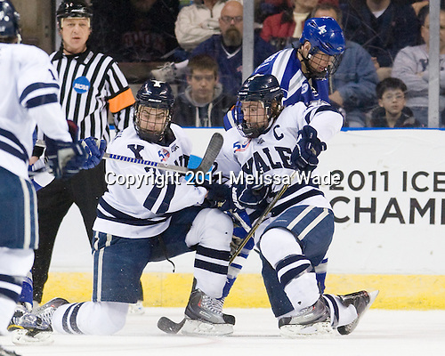 Mike Matczak (Yale - 7), Jimmy Martin (Yale - 2), Kyle De Laurell (Air Force - 9) - The Yale University Bulldogs defeated the Air Force Academy Falcons 2-1 (OT) in their East Regional Semi-Final matchup on Friday, March 25, 2011, at Webster Bank Arena at Harbor Yard in Bridgeport, Connecticut.