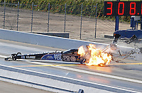 Feb. 17, 2013; Pomona, CA, USA; NHRA top fuel dragster driver Antron Brown explodes an engine in flames blowing a tire and crashing during the Winternationals at Auto Club Raceway at Pomona. Antron would be uninjured in the incident.  Mandatory Credit: Mark J. Rebilas-