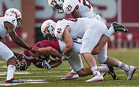 STAFF PHOTO ANTHONY REYES &bull; @NWATONYR<br /> Arkansas receiver Cody Hollister is tackled and facemasked by Northern Illinois University safety Marlon Moore (2) linebacker Sean Folliard (40) and Paris Logan (29) in the first quarter Saturday, Sept. 20, 2014 at Razorback Stadium in Fayetteville.