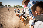 "Winnemucca's Tri County Fair, Labor Day weekend..""I don't want to ride! I don't want to ride!..A Native American boy rides a calf at the urging of his father and grandfather at the rodeo."