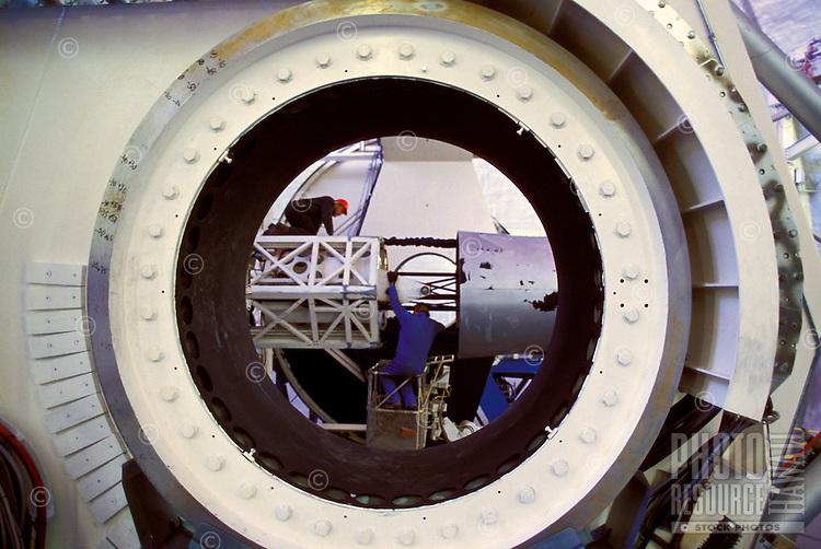Man performing maintenance the keck telescope on Mauna Kea