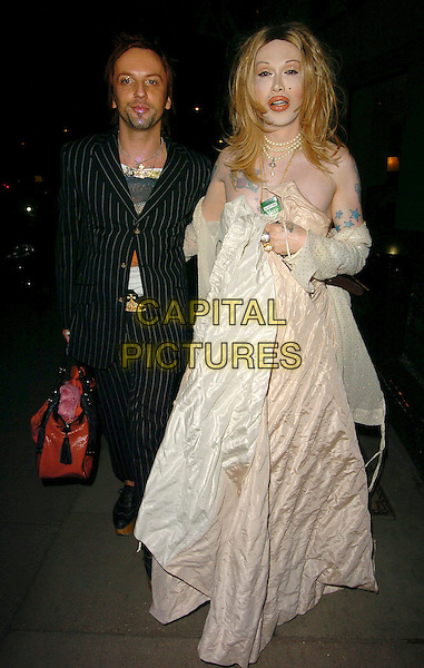 PETE BURNS & PARTNER.At the Miss Great Britain Awards,.Grosvenor House Hotel, London, .25th February 2006..full length make-up tattoo tattooes wig.Ref: CAN.www.capitalpictures.com.sales@capitalpictures.com.©Capital Pictures
