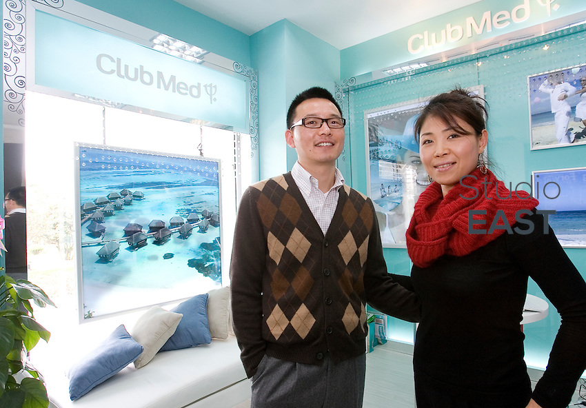 Wang Hanxiang (left) and Li Xiangyu (right) are middle-class Chinese and clients of Club Med travel agency. They pose in the brand's store at Biyun road, in Shanghai, China, on March 27, 2010. Photo Lucas Schifres/Pictobank