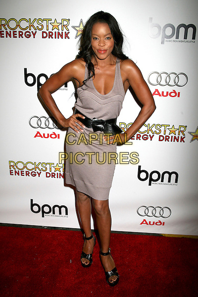 GOLDEN BROOKS.BPM Magazine Celebrates 10th Anniversary at Avalon, Hollywood, California, USA..August 9th, 2006.Photo: Byron Purvis/AdMedia/Capital Pictures.Ref: ADM/BP.full length grey gray dress hands on hips black belt.www.capitalpictures.com.sales@capitalpictures.com.©Byron Purvis/AdMedia/Capital Pictures.