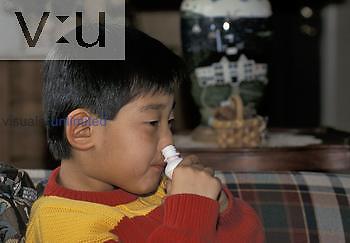 Boy using nasal spray ,Korean, age 6 years,. MR.