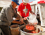 """Jose Gomez of Antioch, and Terry Gilliam, of Martinez prepare steamed crawdads at the """"Louisiana Cajun Lady"""" booth at the 29th annual Pittsburg Seafood and Music Festival in Pittsburg, California, on Sunday, September 8th, 2013.  Photo/Victoria Sheridan"""