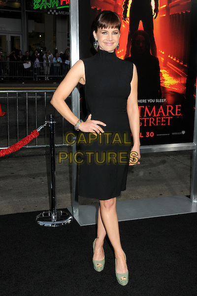 """CARLA GUGINO .""""A Nightmare On Elm Street"""" Los Angeles Premiere held at Grauman's Chinese Theatre, Hollywood, California, USA, 27th April 2010..full length black dress hand on hip sleeveless green platform peep toe shoes .CAP/ADM/BP.©Byron Purvis/AdMedia/Capital Pictures."""