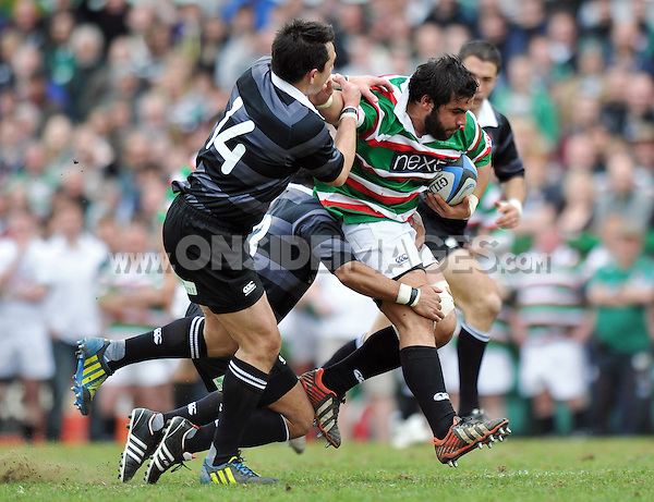 Riccardo Brugnara is double-tackled. Leicester Tigers Legends Match, between Louis Deacon's Tigers Legends and the Matt Hampson's International Legends on April 21, 2013 at Welford Road in Leicester, England. Photo by: Patrick Khachfe / Onside Images