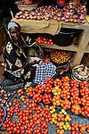 BURKINA FASO, Bobo Dioulasso, Grande MARCHE, great market, muslim woman sells vegetables / Grosser Markt, Verkauf von Gemuese, Tomaten