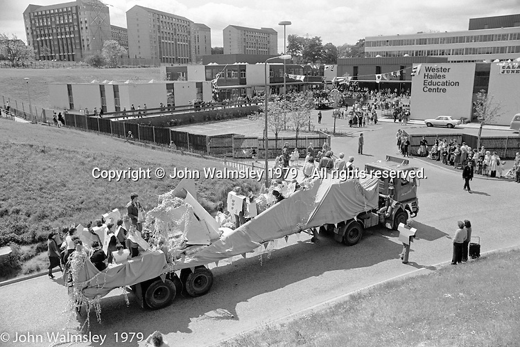 The procession arriving at the Education Centre, Festival & Gala Day, Wester Hailes, Scotland, 1979.  John Walmsley was Photographer in Residence at the Education Centre for three weeks in 1979.  The Education Centre was, at the time, Scotland's largest purpose built community High School open all day every day for all ages from primary to adults.  The town of Wester Hailes, a few miles to the south west of Edinburgh, was built in the early 1970s mostly of blocks of flats and high rises.