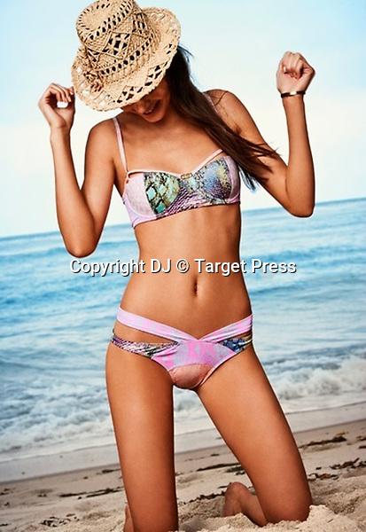 Kendall Jenner swimwear collection Agua Bendita summer 2014<br /> <br /> <br /> &copy; DJ / Target Press - 16/09/2013 - *Hands Out Pics*