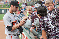 Fresno Grizzlies shortstop Nick Noonan (12) signs autographs before the Pacific Coast League baseball game against the Round Rock Express on June 22, 2014 at the Dell Diamond in Round Rock, Texas. The Express defeated the Grizzlies 2-1. (Andrew Woolley/Four Seam Images)