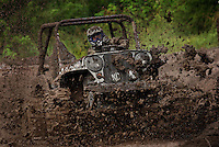 Mud bogs are weekend fun on Prince of Wales Island.  They are run on the site of a former mill.  When the timber industry took a downturn and  it closed, the town was depressed.  They got  money from the forest service to hire a consultant that advised they should have an annual event.  They started the skunk cabbage festival and then added the mud bog six years ago.  Drivers compete with each other, timed as they drive through a water-logged muddy course.