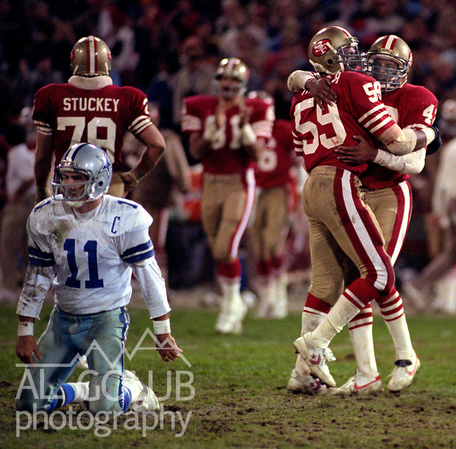 San Francisco 49ers vs. Dallas Cowboys at Candlestick Park Monday, December 19, 1983..49ers beat the Cowboys  42-17.San Francisco 49ers Defensive Back Ronnie Lott (42) and Linebacker Willie Harper (59) celebrate Sacking Dallas Cowboys Quarterback Danny White (11)..