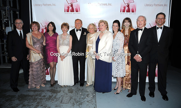 """authors Mary Karr,Robert Bradford, Liz Smith,Barbara Taylor Bradford, Sara Gruen and Norris Church Mailer, Peter Brown and David Finkel posing for photographers at the 26th Annual Literacy Partners Gala with Star-Studded """"Evening of Readings""""  on May 10. 2010 at The Koch Theatre at Lincoln Center in New York City."""