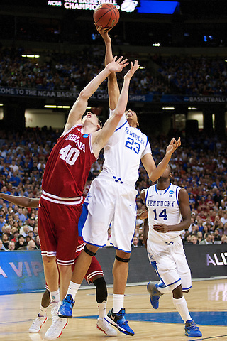 Kentucky Wildcats forward Anthony Davis and Indiana Hoosiers forward Cody Zeller battle for a loose ball. Kentucky faced Indiana during the Sweet 16 round of the 2012 NCAA Tournament at the Georgia Dome in Atlanta,  March 23, 2012. Photo by Derek Poore