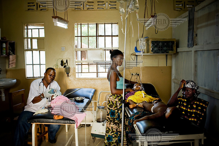 An MSF (Medecins sans Frontieres) nurse treats a child with malaria in the ICU (intensive care unit) of MSF Gondama hospital in Bo.