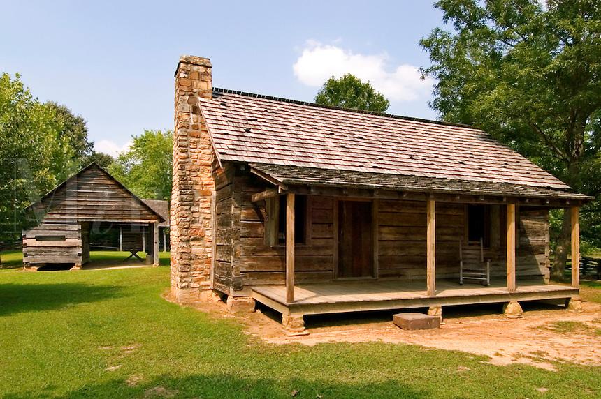 Main dwelling, corn crib, and barn on a typical Cherokee farm, at New Echota, Georgia.