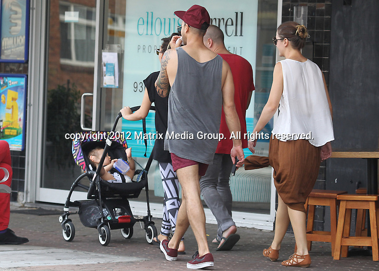 1 DECEMBER 2012 SYDNEY AUSTRALIA ..EXCLUSIVE ..Guy Sebastian pictured with his wife Jules and X Factor winner Samantha Jade with boyfriend Christian Nilssen as they take a late afternoon walk to Bronte with baby Hudson. Guy is the dotting Dad as he races and twirls 9 month old Hudson along in his pram to the amusement of mum and Samantha. ....*No internet without clearance*.MUST CALL PRIOR TO USE ..+61 2 9211-1088.Matrix Media Group.Note: All editorial images subject to the following: For editorial use only. Additional clearance required for commercial, wireless, internet or promotional use.Images may not be altered or modified. Matrix Media Group makes no representations or warranties regarding names, trademarks or logos appearing in the images.