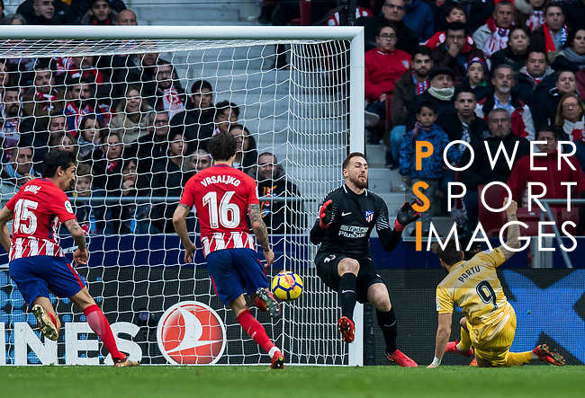 Goalkeeper Jan Oblak (2nd R) of Atletico de Madrid fails to save the ball shot by Cristian Portugues Manzanera, Portu, (R) of Girona FC during the La Liga 2017-18 match between Atletico de Madrid and Girona FC at Wanda Metropolitano on 20 January 2018 in Madrid, Spain. Photo by Diego Gonzalez / Power Sport Images