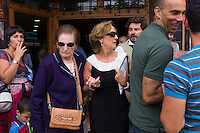 Two generations of women at crowded Sidreria bar during traditional fiesta at Villaviciosa in Asturias, Northern Spain