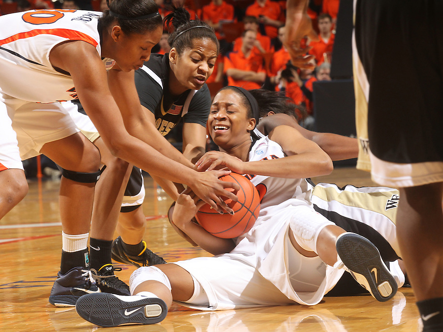 Feb. 3, 2011; Charlottesville, VA, USA; Virginia Cavaliers guard Whitny Edwards (2), middle, fights for the loose ball with Wake Forest Demon Deacons forward Brittany Waters (20) during the game at the John Paul Jones Arena.  Mandatory Credit: Andrew Shurtleff