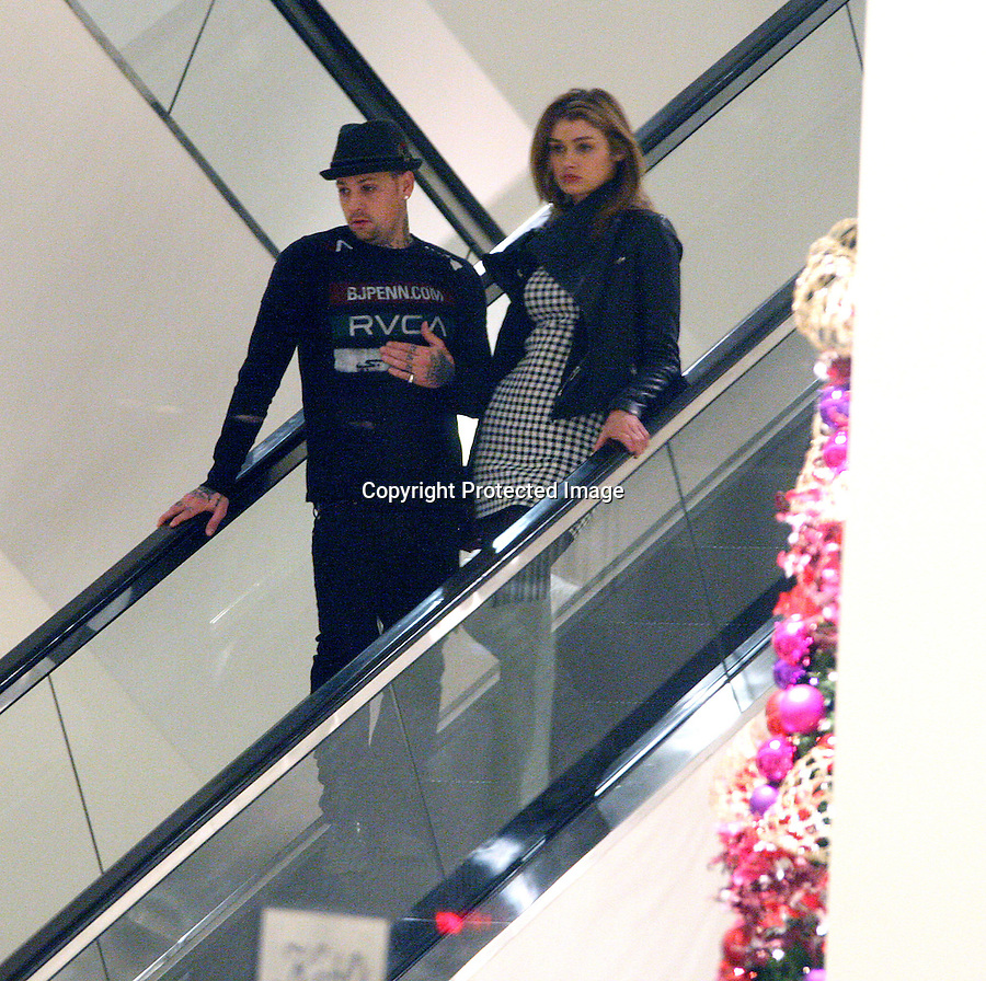 ..December 9th 2010  Exclusive..New couple alert Benji Madden with model girl friend ate lunch together at Chipotle Mexican food restaurant on Sunset Blvd in West Hollywood. After the couple finished eating Benji waited outside for about 20 minutes while his new model girl friend went next door to a model agency..Then Benji Madden took his new model girlfriend shopping at Neiman Marcus in Beverly Hills. Benji was being very sneaky trying not to be photographed with the model. Benji was wearing a UFC fighter BJ Penn.com t-shirt RVCA. ..AbilityFilms@yahoo.com.805-427-3519.www.AbilityFilms.com