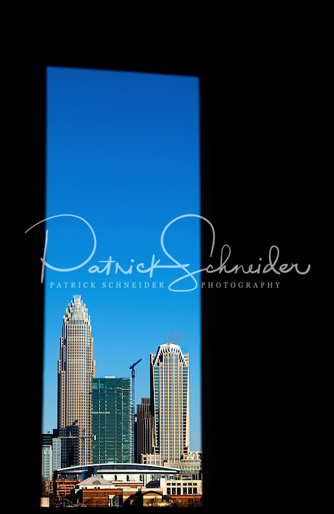 A narrow skyline view of downtown Charlotte North Carolina shows Bank of America's shiny (glassy) new tower, still under construction early 2010. Photo by Charlotte-based photographer Patrick Schneider.