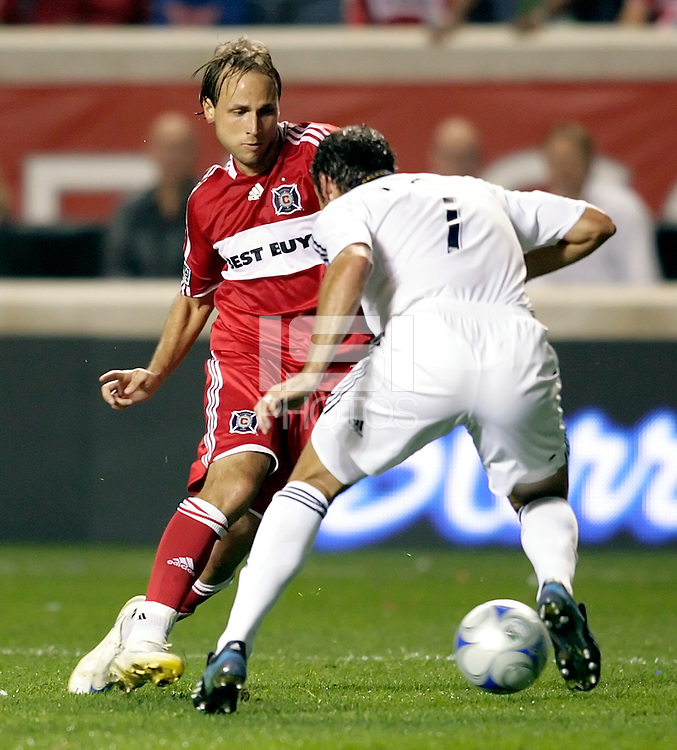 Chicago Fire midfielder Justin Mapp (21) makes a move to get past LA Galaxy defender Chris Klein (7).  The Chicago Fire defeated the LA Galaxy 3-1 at Toyota Park in Bridgeview, IL on September 25, 2008.  Photo by Tracy Allen/isiphotos.com