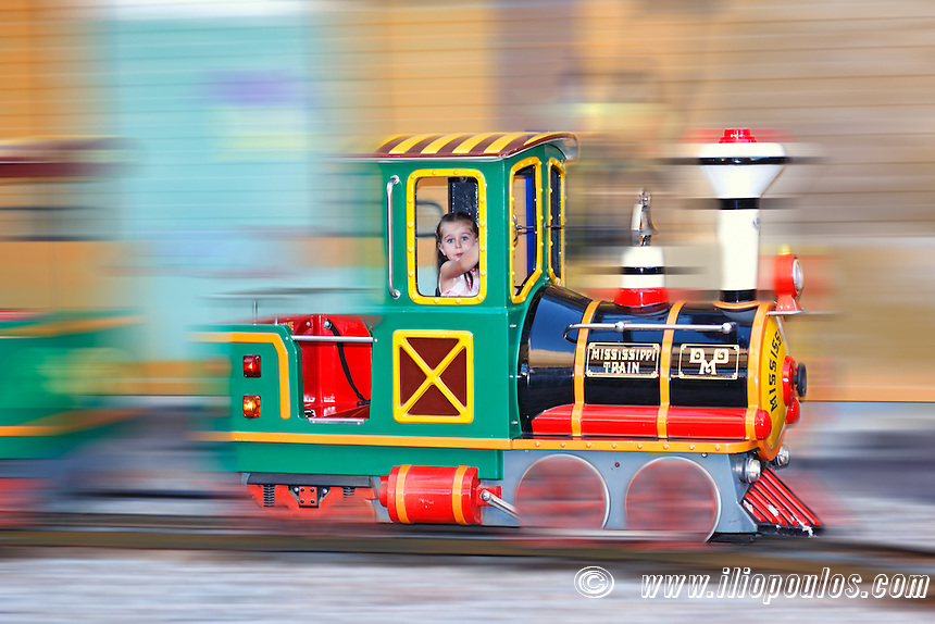 A pretty little girl having fun with train