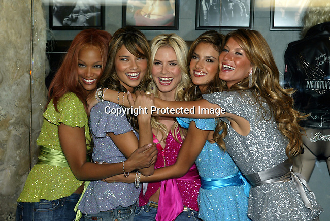"""11/11/04,LAS VEGAS,NEVADA --- Victoria's Secret supermodels (L-R)Tyra Banks, Adriana Lima, Alessandra Ambrosio, Heidi Klum and Gisele Bundchen. are inducted in the Hard Rock Hotel and Casino Hall of Fame where they will donate one-of-a-kind memorabilia. Victoria's Secret celebrates the 2004 holiday season with a first-ever nationwide tour """"Angels Across America""""."""