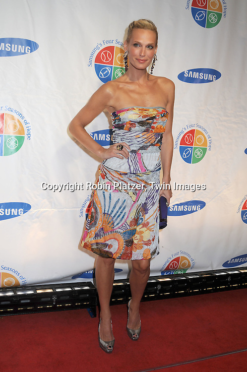 actress Molly Sims in Missoni dress..attending Samsung's 8th Annual Four Seasons of Hope Gala on June 16, 2009 at Cipriani's Wall Street in New York City. ..Robin Platzer, Twin Images