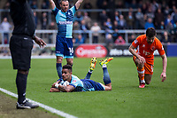 Paris Cowan-Hall of Wycombe Wanderers is fouled by Jordan Flores of Blackpool during the Sky Bet League 2 match between Wycombe Wanderers and Blackpool at Adams Park, High Wycombe, England on the 11th March 2017. Photo by Liam McAvoy.