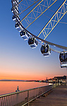 Seattle, Washington<br /> Seattle Great Wheel, a Ferris wheel on the Elliott Bay waterfront at dusk