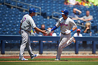 Midland RockHounds shortstop Chad Pinder (10) congratulated by manager Ryan Christenson (7) after hitting a home run during a game against the Tulsa Drillers on June 3, 2015 at Oneok Field in Tulsa, Oklahoma.  Midland defeated Tulsa 5-3.  (Mike Janes/Four Seam Images)