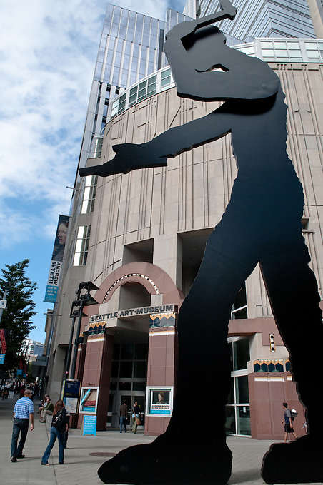 Downtown branch of Seattle Art Musuem with Hammering Man sculpture by Jonathan Borofsky in foreground. Photograph by Robert Wade.