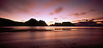 Rugged Point at Mason Beach on Stewart Island at sunset. New Zealand