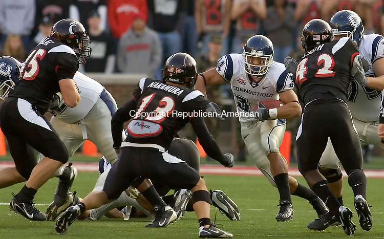 CINCINNATI, OH --11 NOVEMBER 2007-111007JS07-UConn's Donald Brown (34) gets met at the line of scrimmage by Cincinnati's Ryan Manalac (45), Haruki Nakamura (13) andCorey Smith (42) during their Big East game Saturday at Nippert Stadium in Cincinnati, Ohio. UConn was only able to gain 22 yards rushing during the game.<br />  Jim Shannon/Republican-American