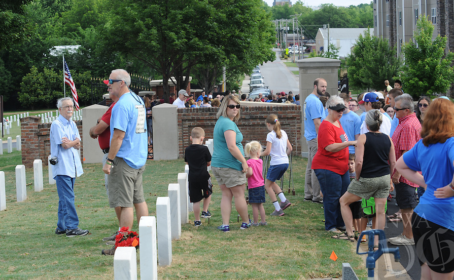 NWA Democrat-Gazette/ANDY SHUPE<br /> Saturday, May 28, 2016, at the Fayetteville National Cemetery. Volunteers placed flags in front of the approximately 8,700 grave markers at the facility ahead of the Memorial Day holiday. A service is planned for 10 a.m. Monday at the cemetery featuring Col. Bobbi Doorenbos, commander of Arkansas Air National Guard&rsquo;s 188th Wing.