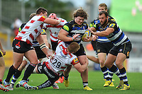 Nick Auterac of Bath Rugby takes on the Gloucester defence. West Country Challenge Cup match, between Gloucester Rugby and Bath Rugby on September 13, 2015 at the Memorial Stadium in Bristol, England. Photo by: Patrick Khachfe / Onside Images
