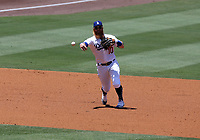25th July 2020, Los Angeles, California, USA;  Los Angeles Dodgers third baseman Justin Turner (10) makes a throw to first base the game against the San Francisco Giants on July 25, 2020, at Dodger Stadium in Los Angeles, CA.
