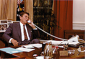 United States President Ronald Reagan talks on the telephone from his desk in the Oval Office of the White House in Washington, D.C. on Tuesday, July 28, 1981..Mandatory Credit: Karl H. Schumacher - White House via CNP