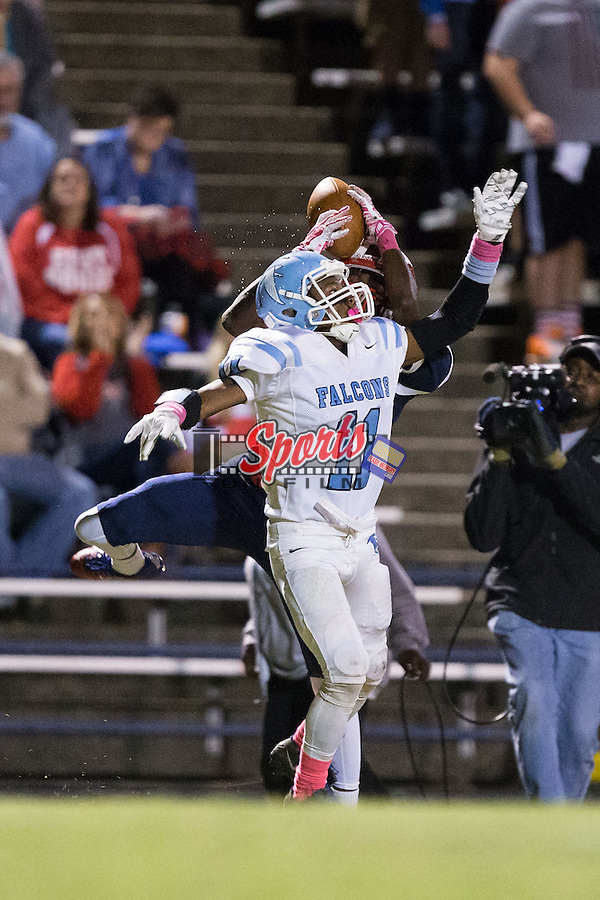 Naquis Caldwell (1) of the East Rowan Mustangs jumps over Daquan Byrd (11) of the West Rowan Falcons in an attempt to catch a pass during first half action at East Rowan High School on October 15, 2015, in Salisbury, North Carolina.  The Falcons defeated the Mustangs 28-7.  (Brian Westerholt/Sports On Film)